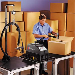 Operator assembling cartons